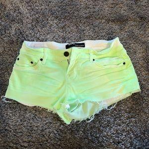Bright green cut off shorts